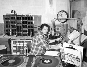 Bill Plummer in the KKIS broadcast booth in March 1967 [Click here to enlarge]